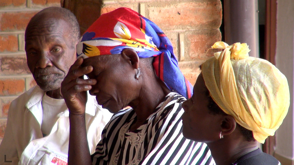 bernad and family members await results of a lab test at a rural private hospital in malawi. (scene from episode 1)