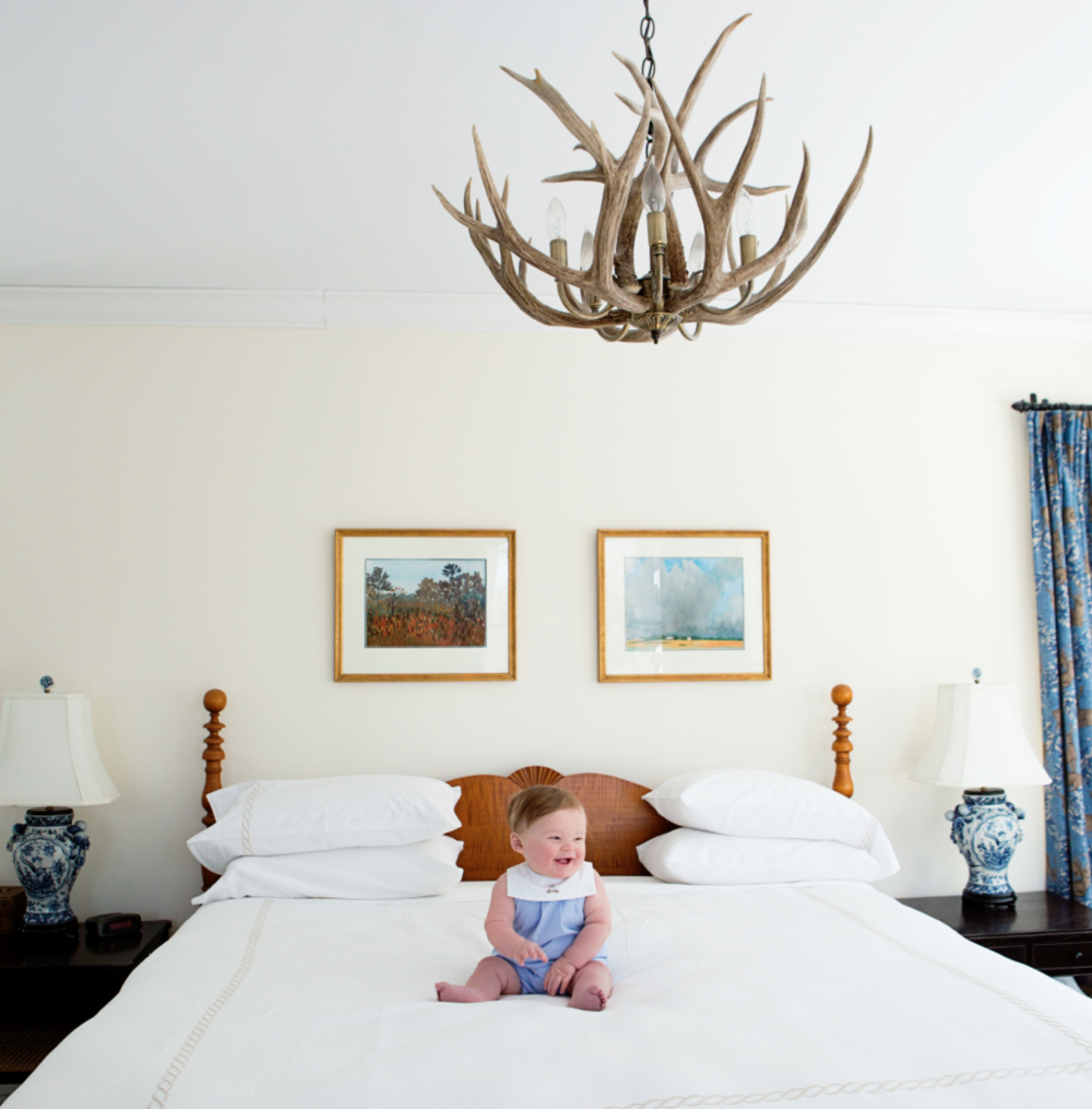 Andrew on the bed antlers.png