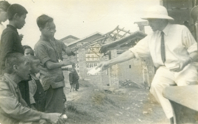 Father handing out tracks in China (1940's)