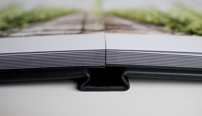 Pages in the album are cut instead of folded allowing for gorgeous full spread photos to be uninterrupted by a gutter.