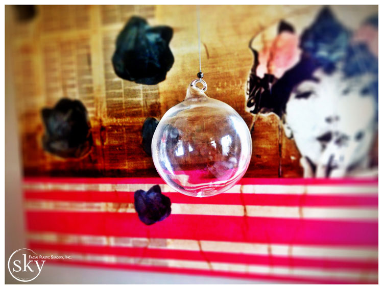 PHOTO: Hand blown glass ball hanging from strand of steel.
