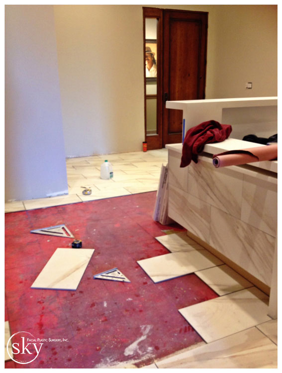 PHOTO: Floor in lobby being installed.