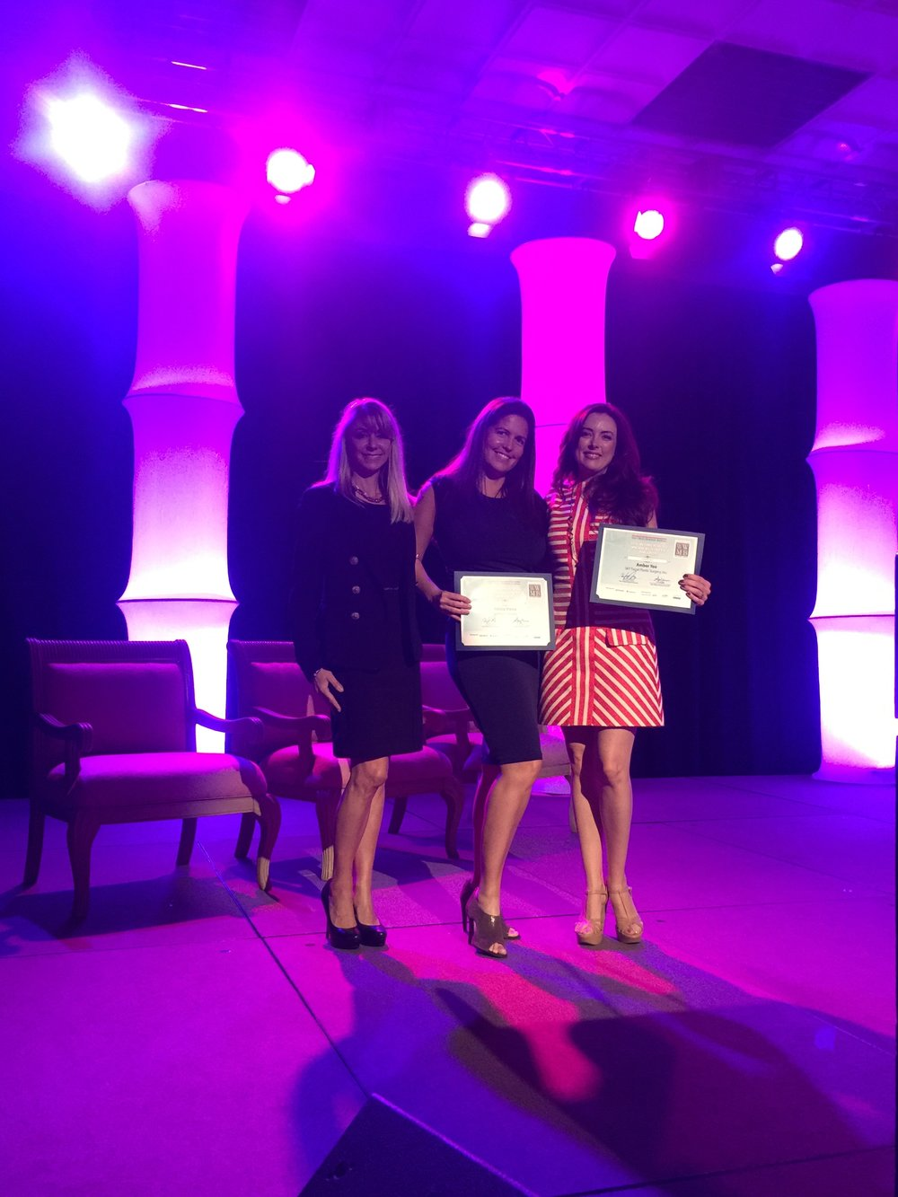 SKY's VP Amber N. Yoo, M.B.A. (far right) on stage at the San Diego Business Journal's Women Who Mean Business award ceremony with fellow honoree Felicia Vieria (middle), owner of Crafted Cocktails and friend.