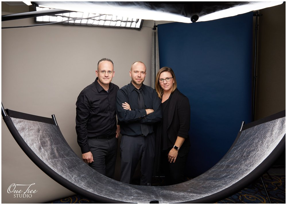 A double backdrop setup with Suede Grey and Ultramarine. AND three of our amazing team members!