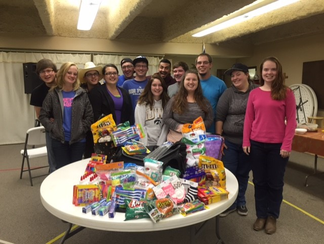 Young Adult Bible Study with the items they collected to send with our missionaries on their trip 11/17-11/28. To read their letter of encouragement to the church please click here