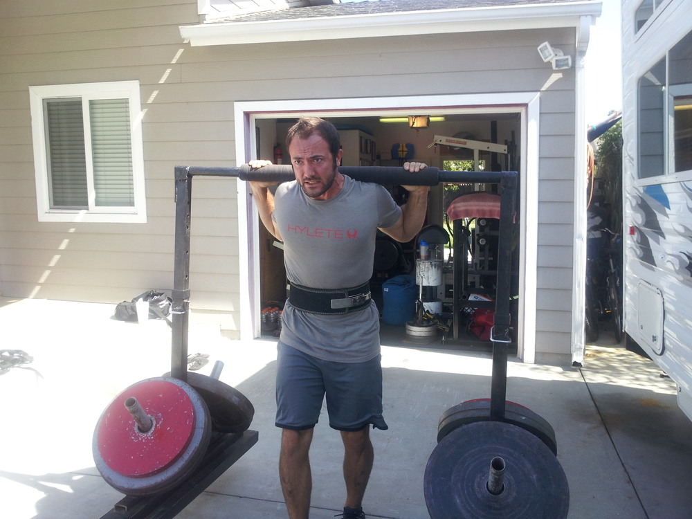 San Diego personal trainer & strongman, Brian Tabor, performing 650# yoke walk.