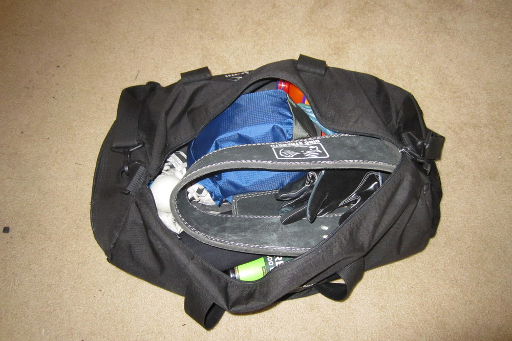 Gym bag full of strongman gear for competition.