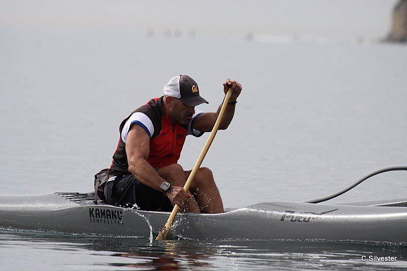 Strong Made Simple Personal Training Client Ric Aguirre paddling in San Diego, CA.