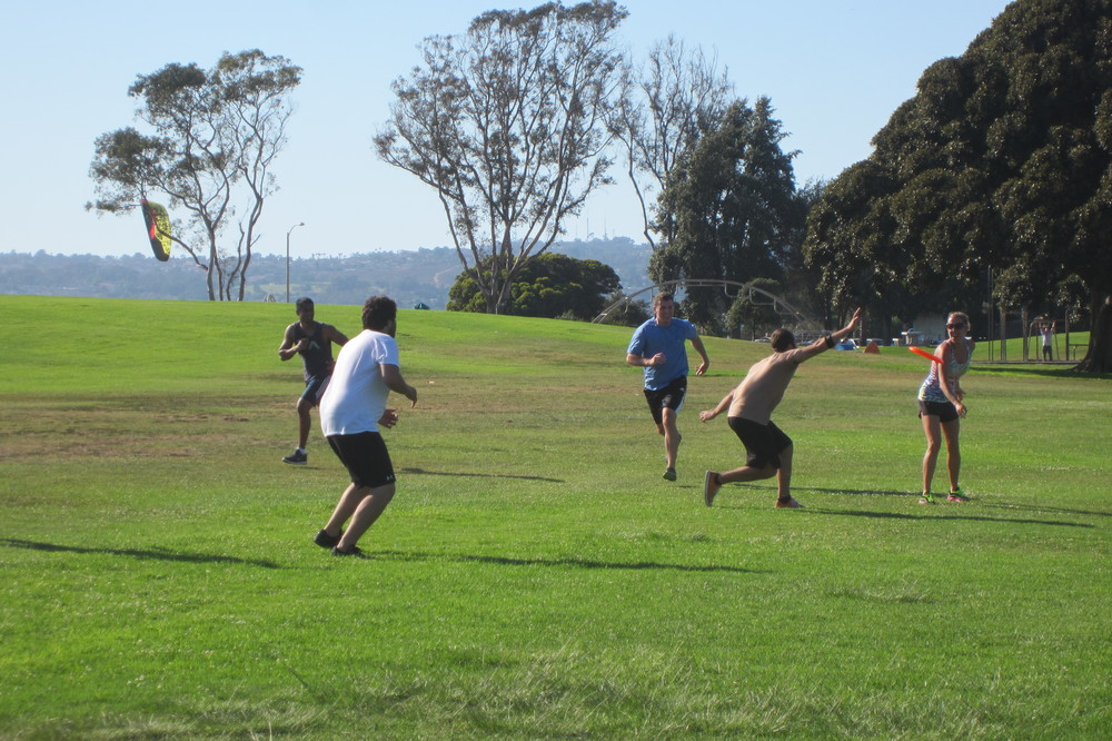 San Diego personal training clients playing ultimate frisbee at a Strong Made Simple event.