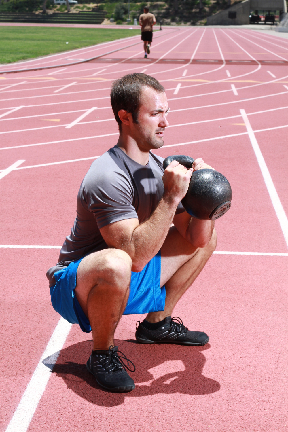 Strong Made Simple Personal Trainer demonstrating a goblet squat. #deepsquatshappythoughts