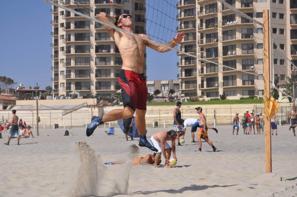 San Diego personal trainer, Rudy, getting some air playing beach volleyball.