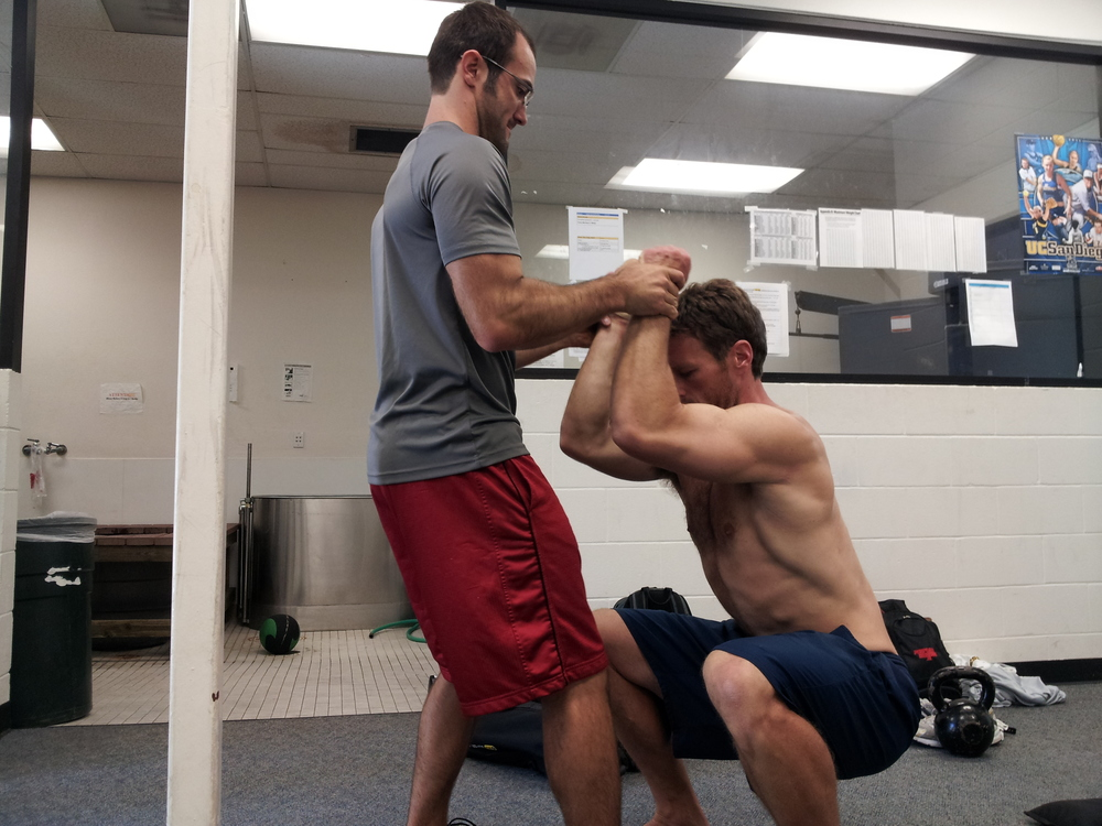 San Diego personal trainer, Brian Tabor, assists Rudy Thomas in hip flexor activation drill.