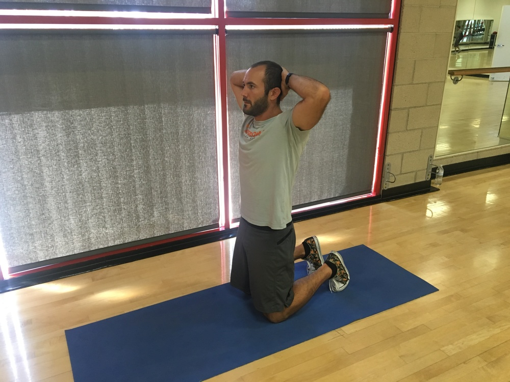 Tall kneeling position. A great way to start engaging the abdominal muscles and glutes to better position the pelvis.