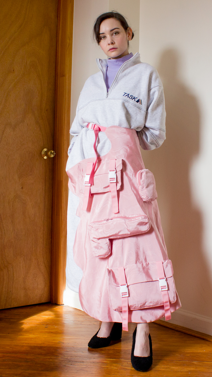pink moire apron with decorative pockets and side release buckles, oversized sweatshirt dress, pastel purple turtleneck and black faux fur Helmut Lang shoes #graduatecollection #fashiondesign #fashiondesignstudent #outfit #fashion