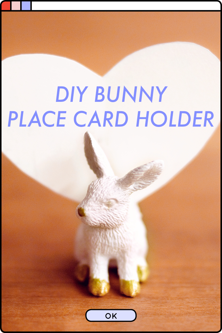 Make a cute animal place card holder using a rubber bunny toy and some gold accent paint for your next dinner party!