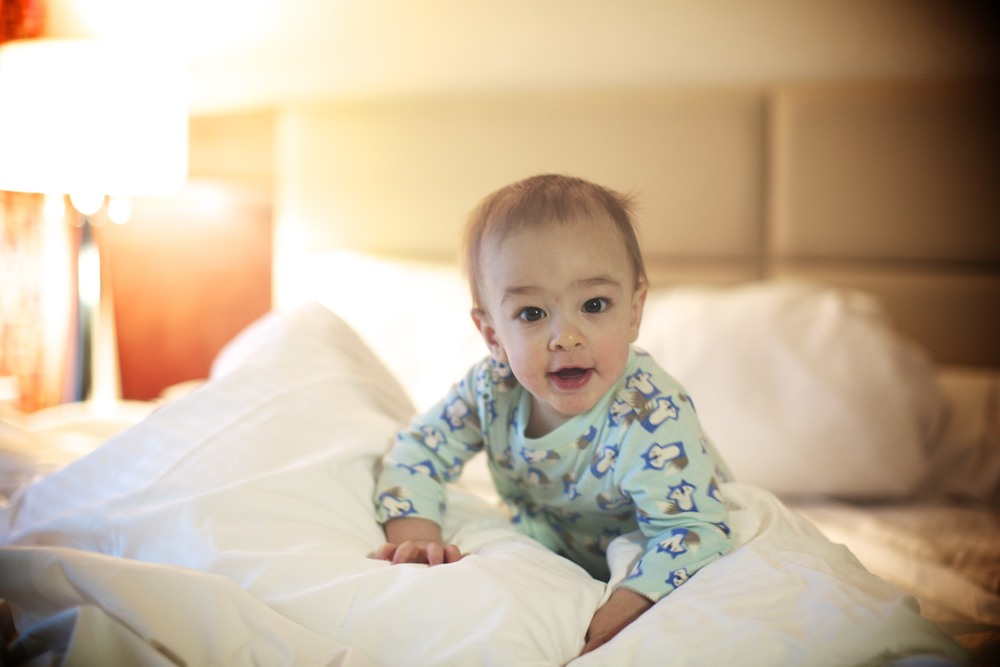 Gracen excitedly knocking down his hotel pillow fort!