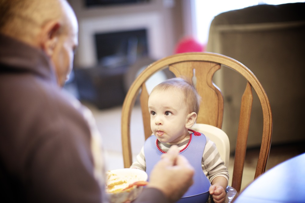 Grandpa doing an awesome job trying his hand at feeding–it's been awhile!