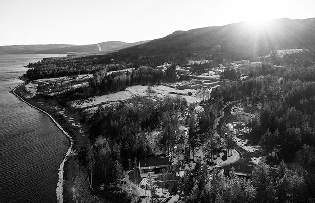 A stunning shot of the last few minutes of light before sunset over our project in Cape Breton.  The team @skylinestudiodigital did an amazing job capturing the beauty of landscape.  We love how the buildings perfectly blend into the forest below.  We are currently finishing the first four buildings onsite, the fifth is nearing completion in the factory and an exciting new addition to the property is in the final stages of design.  #prefab #modernprefab #modularhome #lloyollbuilt #nicholasfudgearchitects #capebreton #modernarchitecture