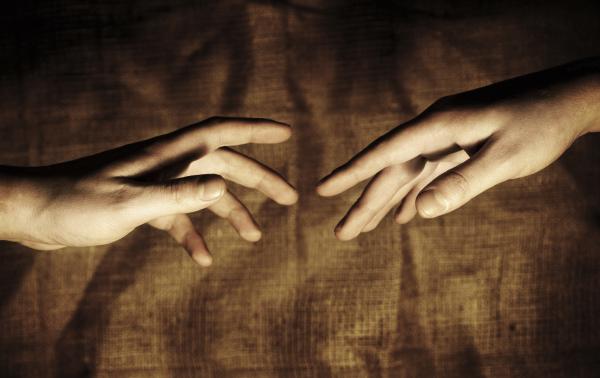 reaching hands small.jpg