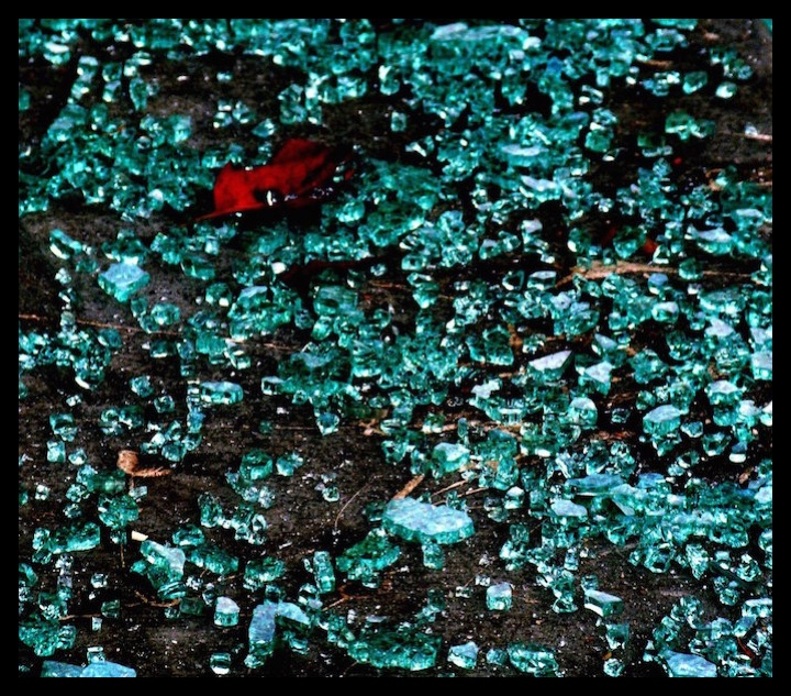 Shards of broken glass. The many shapes of each piece of glass and the reflection of light beaming it.