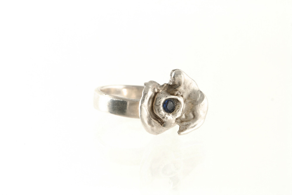 OOAK silver flower ring with blue CZ.