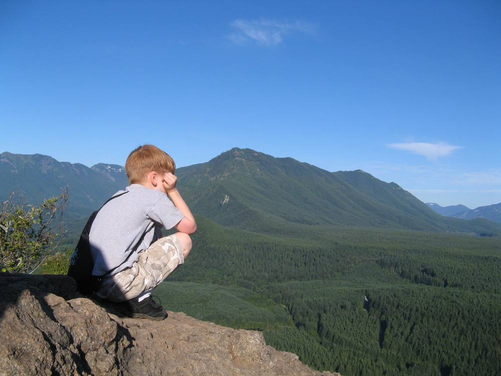Boy #3 looking out over the great expanse of the Cascades from Rattlesnake Ledge just east of Seattle.