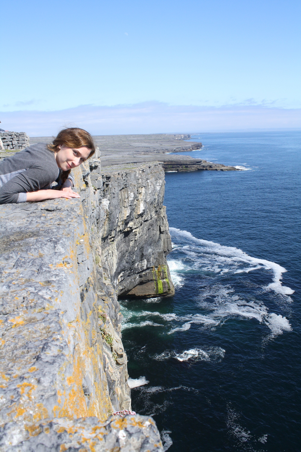 Carefully looking over cliffs on Aran Islands