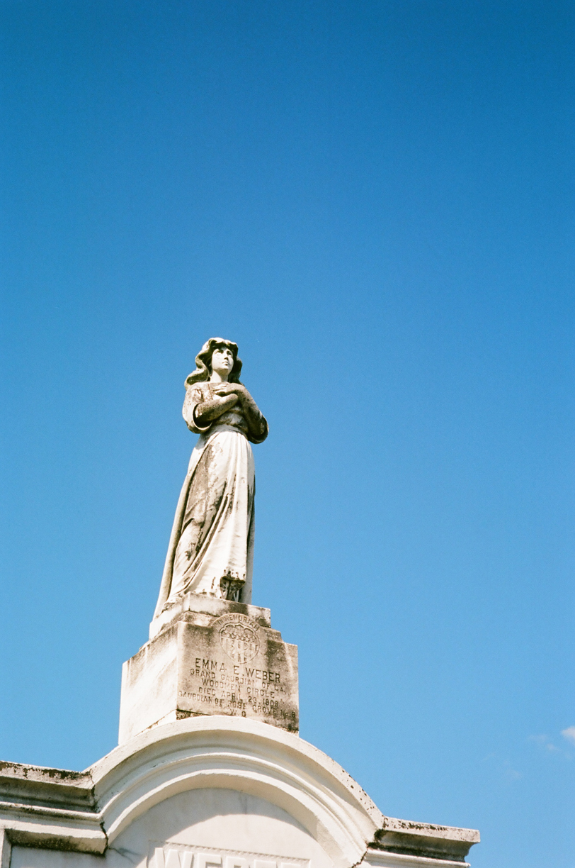 Woman with Arms Crossed Looking Up_Weber Statue_Lake Lawn Metairie cemetery_Web.jpg