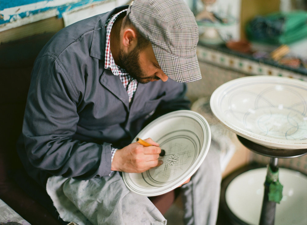 man at co-op drawing design on bowl_fez_web.jpg
