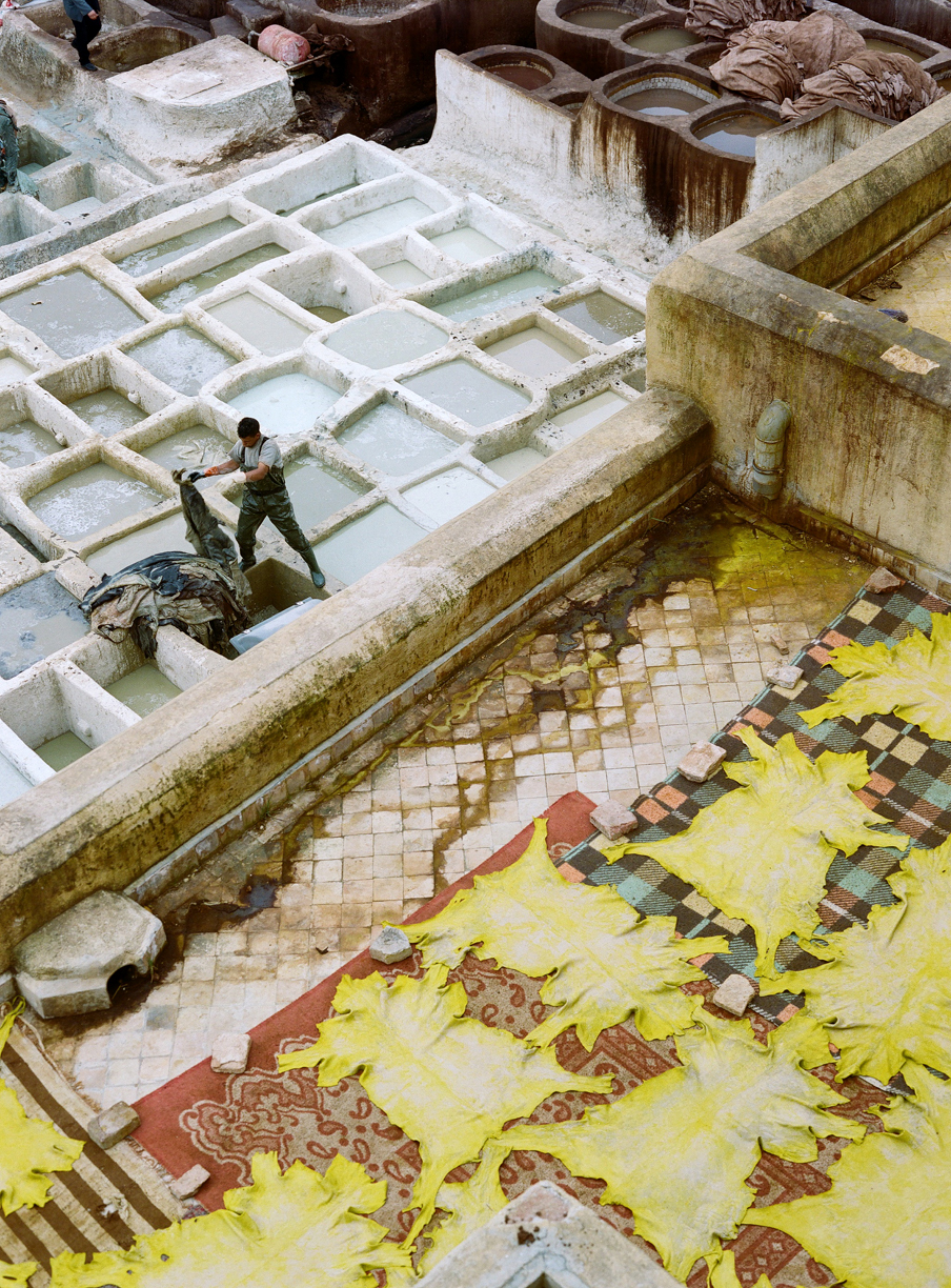man at white wash pools and yellow hides_fez tannery_web.jpg