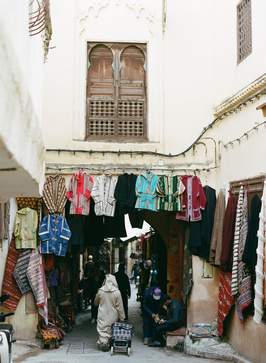 Man walking with cart in fez medina_web.jpg