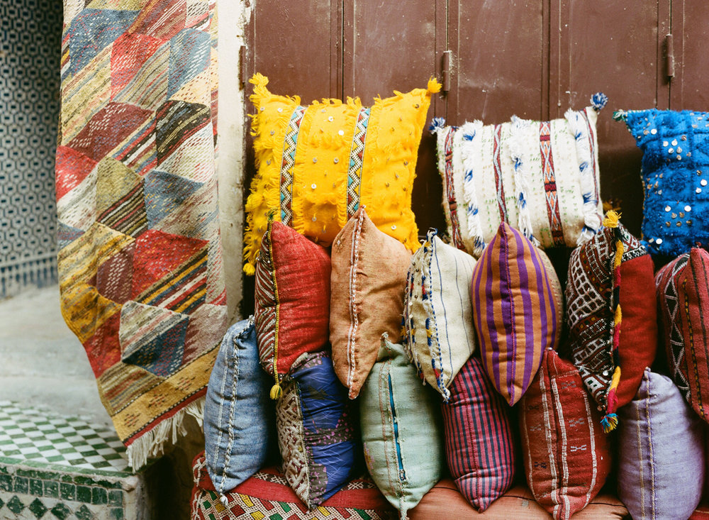 Moroccan pillows and rug_medina in fez_web.jpg