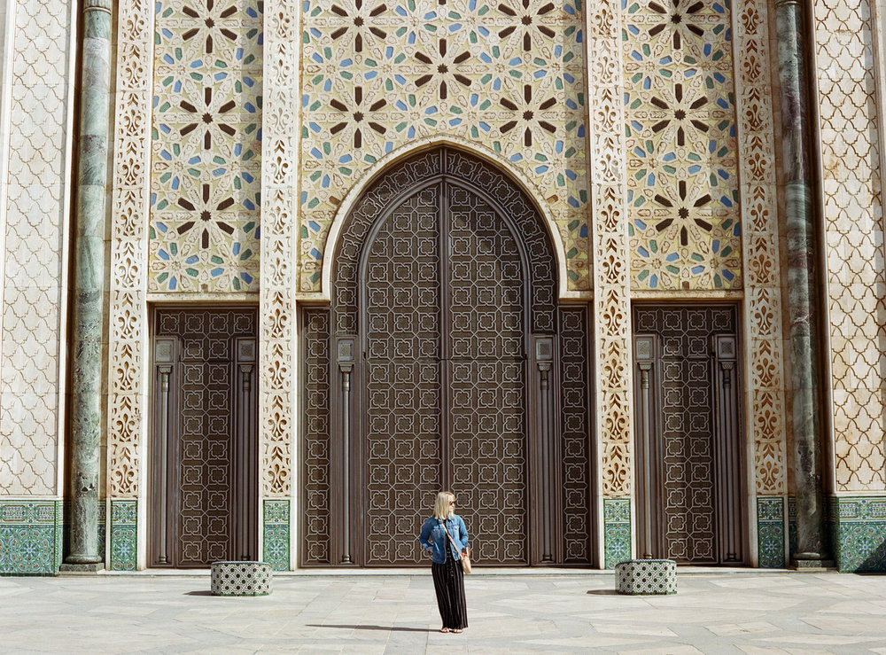 Allison looking to side in front of brown door_hassan mosque II_web.jpg