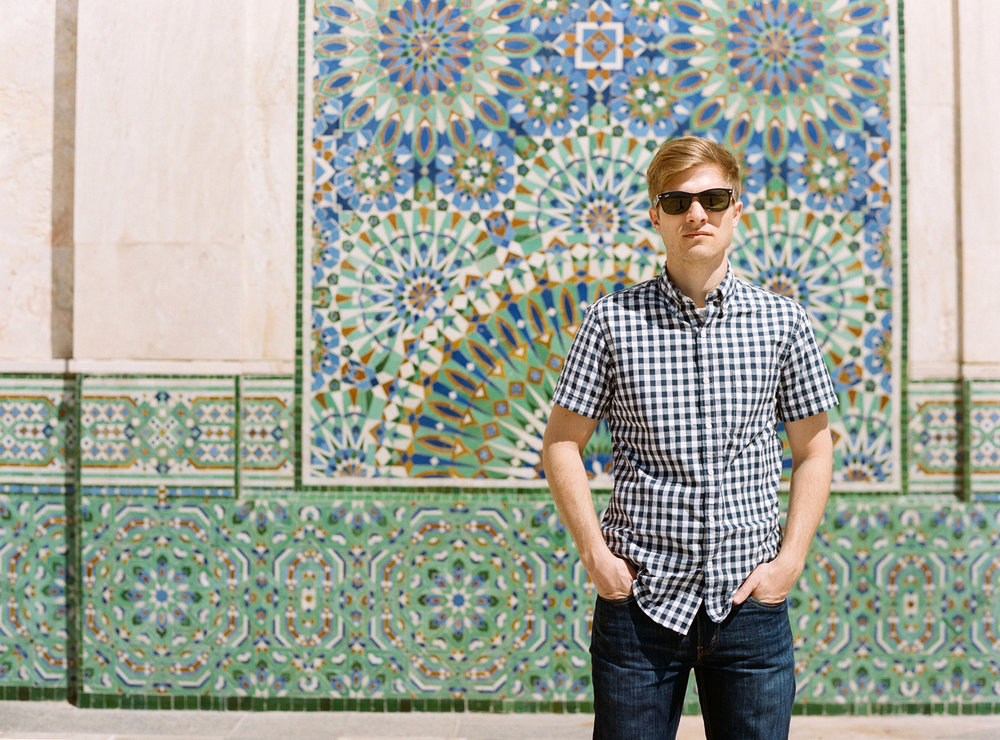 Cole in front of tile wall at hassan mosque II_web.jpg