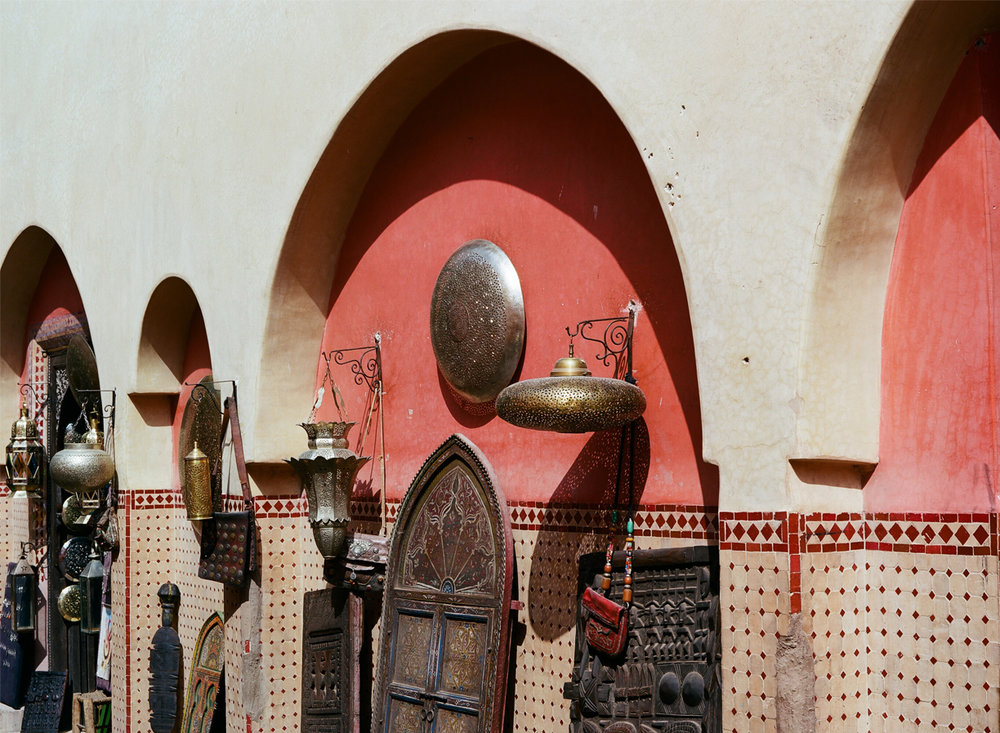 Arches and Red Walls with goods along It Being Sold inside Medina_web.jpg