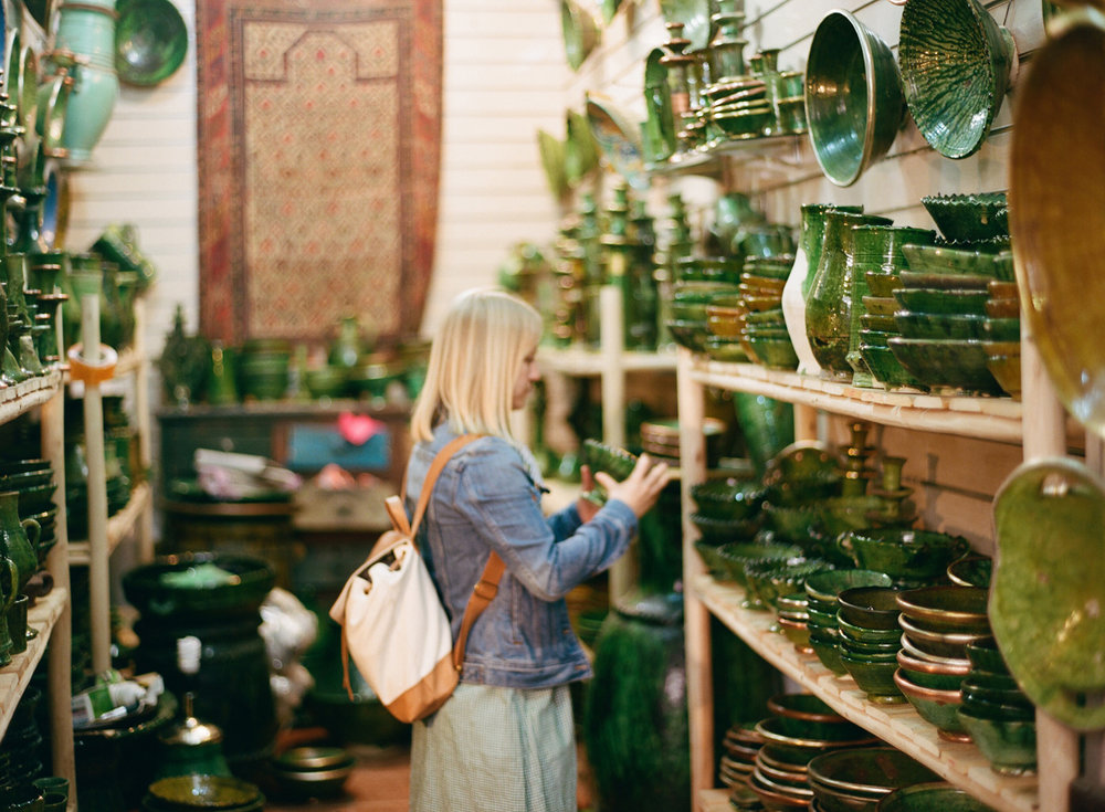 Allison Looking at green pottery in shop_Marrakech medina_web.jpg