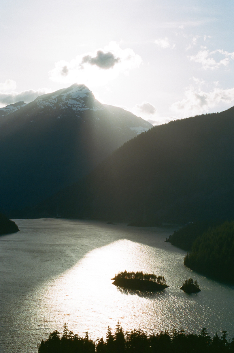 Cascades and Diablo Lake Overview at Dusk_Sun Behind Clouds_web.jpg