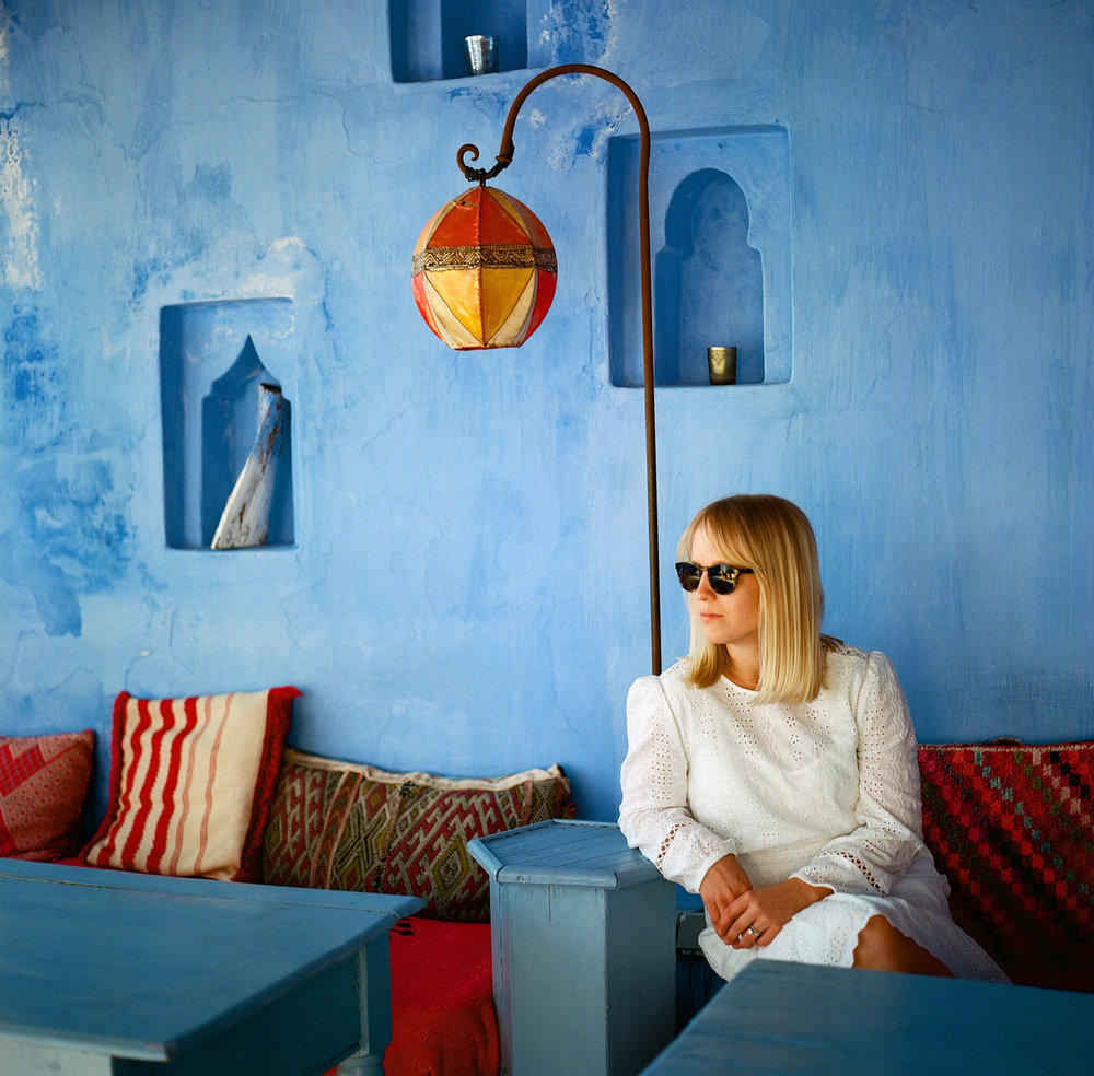 Allison with Shades on deck of riad in Chefchaouen_web.jpg