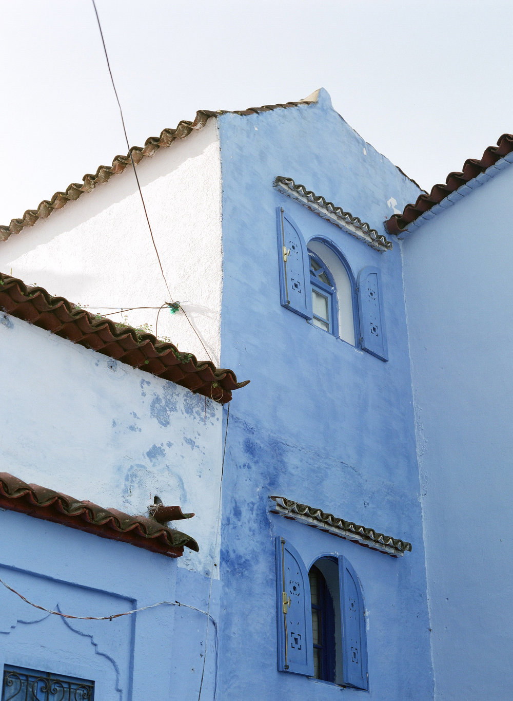 Two Windows and Wire on Building in Chefchaouen.jpg