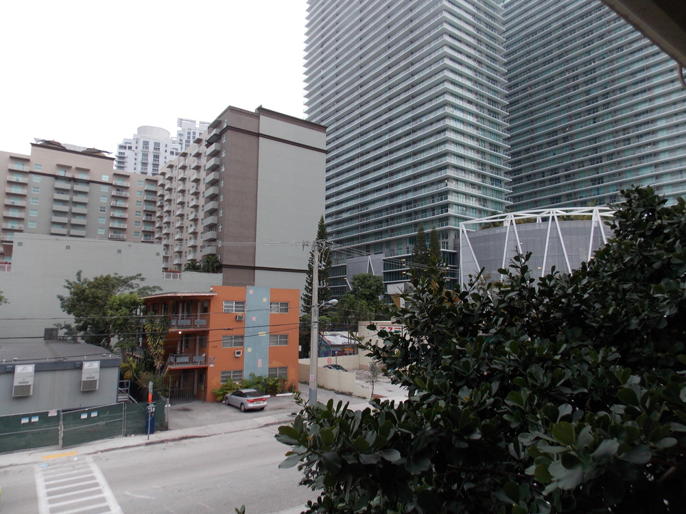 The Brickell neighborhood is seeing lots of new development, along side reminders of Miami's past, but lacks elements to make walking feel safe or easy to navigate. (Photo: M. Zimmerman, 2013)