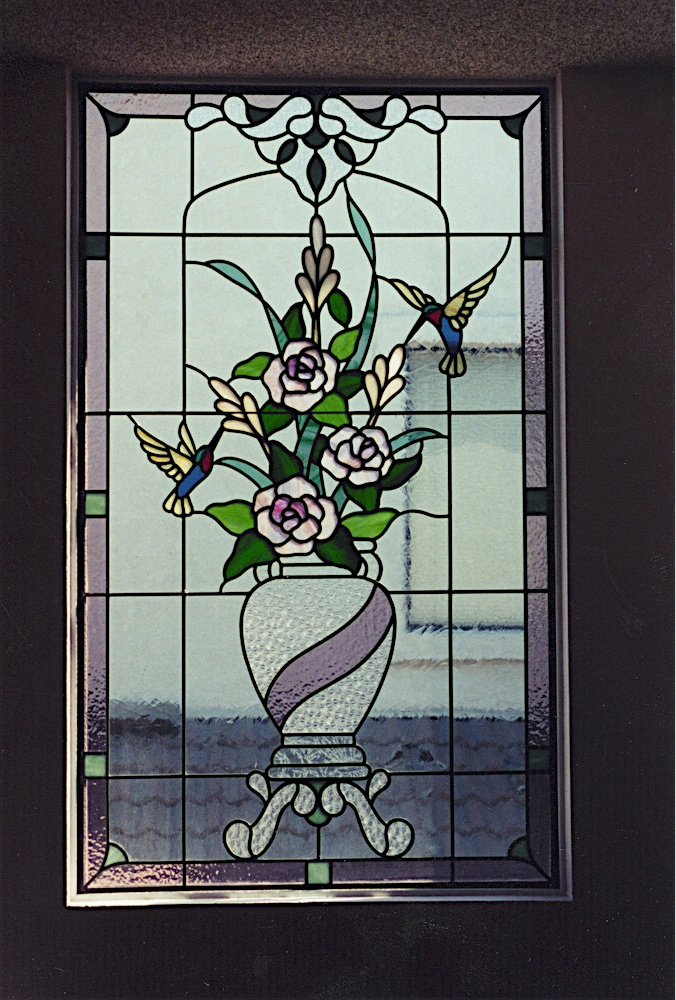 Vase with flowers and hummingbirds.jpg