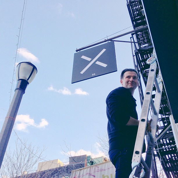 Up on a ladder at Jnrlstr, at 55 Clinton Street inspecting the new sign. ©KristinSloan via Instagram