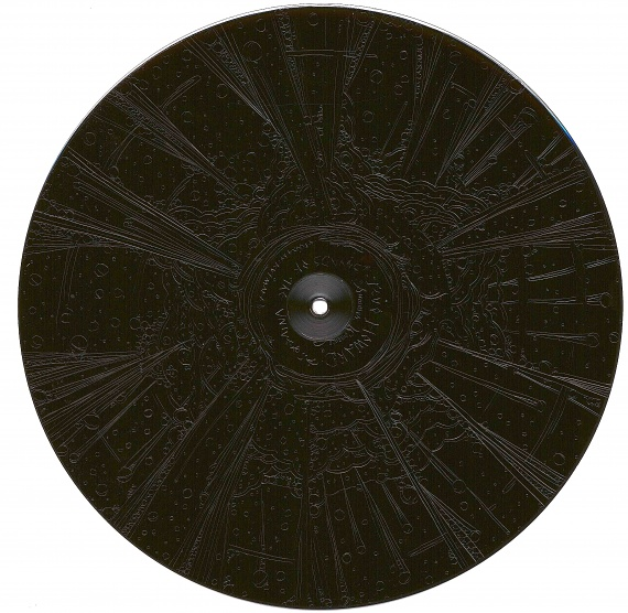 "the ""non-playable"" backside of the vinyl record features a lovely hand etched work by Kutmah."