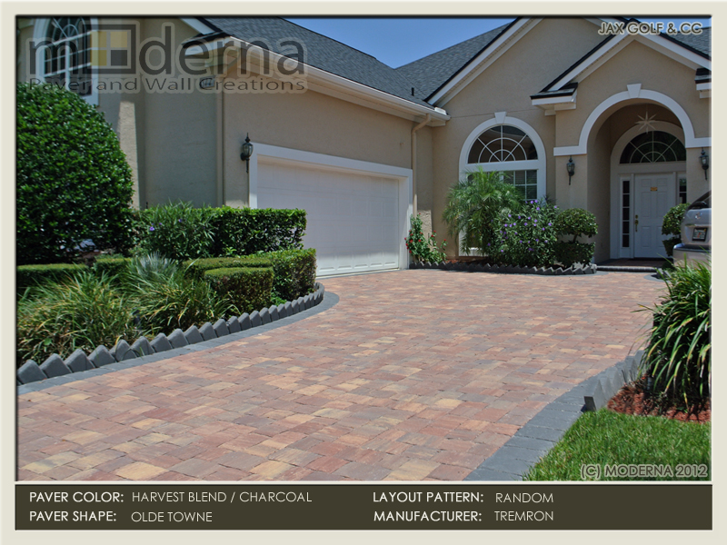 Brick Paver driveway installation in Jacksonville FL. Olde Towne pavers in a random layout pattern. Harvest Blend color with a Charcoal border.