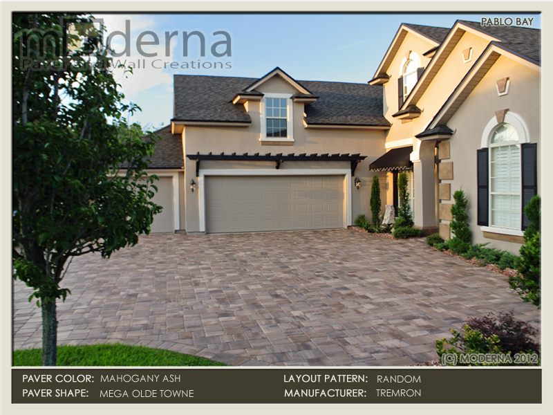 Paver driveway installation in Jacksonville Fl by Moderna. Mega Olde Towne pavers in a random pattern. Mahogany Ash color.
