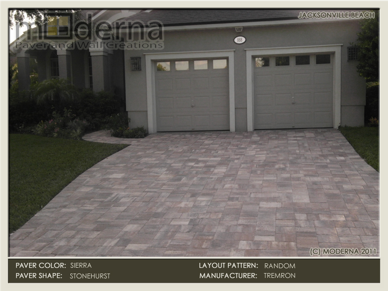 Brick paver driveway construction in Jacksonville Beach FL. Stonehurst style pavers laid out in a Random pattern. Sierra color pavers.