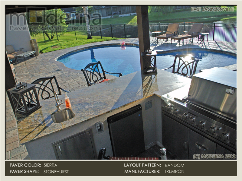 Paver pooldeck, pergola, bar, hot tub, and outdoor kitchen area. Stonehurst pavers in Sierra color. Jacksonville FL.