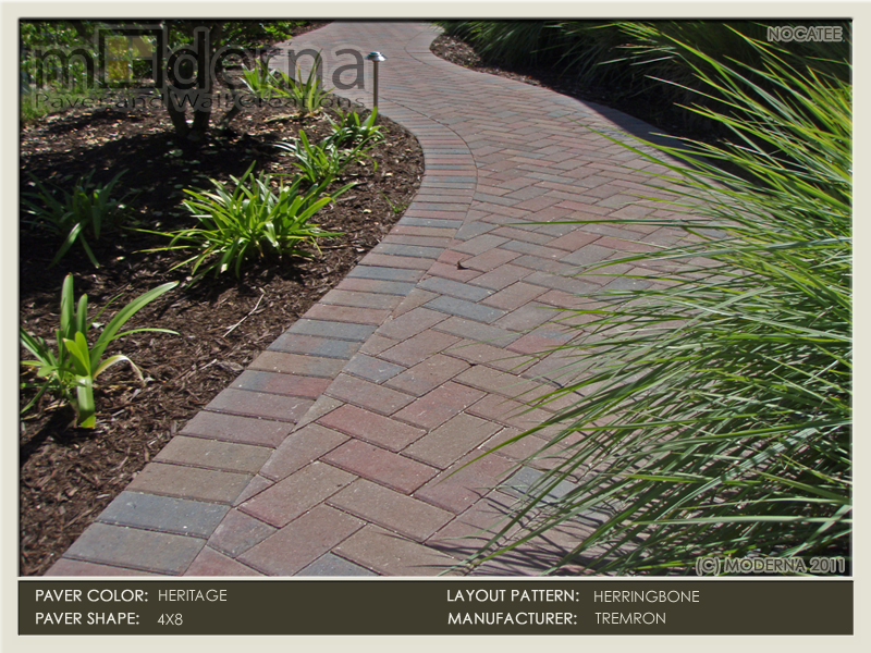 A brick paver walkway featuring 4 x 8 pavers in a traditional 45 degree herringbone pattern. The color used is Heritage- Red, Tan, and Charcoal.