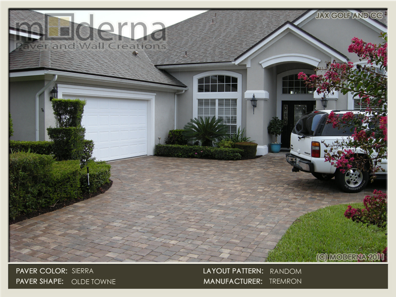 Paver driveway installation in Jacksonville FL. The pavers are Tremron's Olde Towne pavers with a 6 x 9 border. Color is Sierra.
