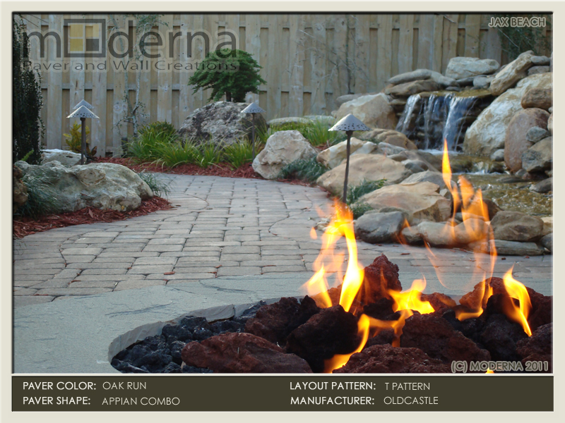 Brick paver patio in Jacksonville Beach featuring a stone fire pit. Pavers are Oldcastle's Oak Run in a 2 piece T Pattern with rectangular border.